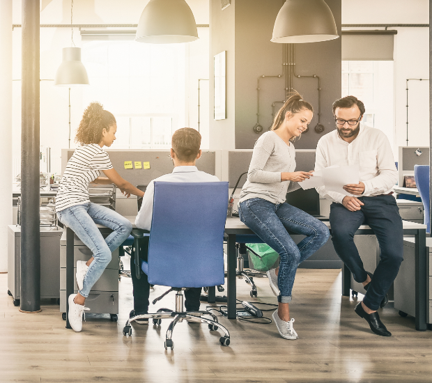 Group of people working together in an office setting