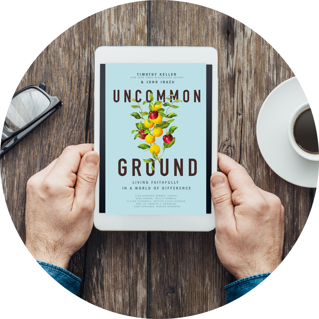 hands holding smart tablet displaying Uncommon Ground book cover